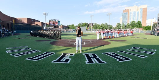 Vanderbilt and Ohio State players line up for the National Anthem sung by Lacy Cavalier during the NCAA Division I Baseball Regionals at Hawkins Field Friday, May 31, 2019, in Nashville, Tenn.