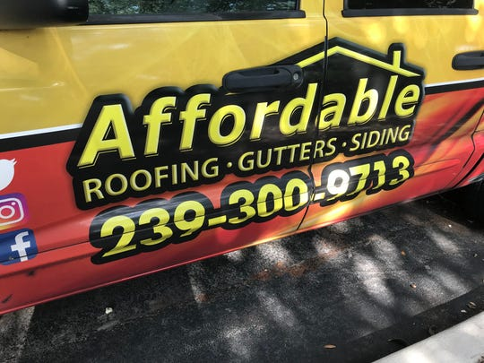 A truck sits outside the offices of My Affordable Roof in Naples on May 30, 2019.
