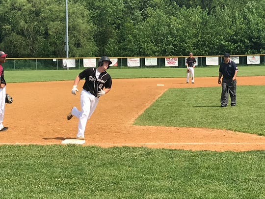 Junior Brian Skettini rounds third base after hitting a three-run home run in the North 1, Group 4 sectional final