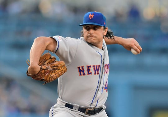 New York Mets starting pitcher Jason Vargas throws during the first inning of the team's baseball game against the Los Angeles Dodgers on Thursday, May 30, 2019, in Los Angeles. (AP Photo/Mark J. Terrill)