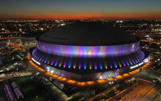 In this Feb. 1, 2013 photo, the Superdome, where the NFL Super Bowl XLVII football game between the San Francisco 49ers and Baltimore Ravens will be played on Feb. 3, is seen at sunset in New Orleans. The Superdome has outlasted seven other domed stadiums from the AstroTurf era that have come and gone, even surviving Hurricane Katrina that forced the Saints to play elsewhere in 2005. The spaceship-like building, which opened in 1975, has hosted seven Super Bowls.