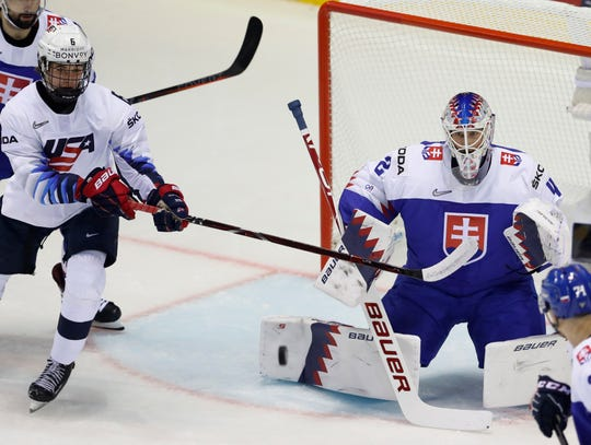 Jack Hughes of the US, left, tries to score past Slovakia's goaltender Patrik Rybar, right, during the Ice Hockey World Championships group A match between Slovakia and the United States at the Steel Arena in Kosice, Slovakia, Friday, May 10, 2019.