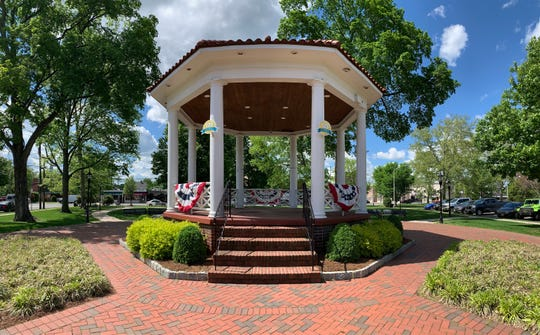 A historic bandstand in Veteran's Memorial Park with 125 anniversary signs where June 8th festivities will take place next week during Celebrate Westwood.