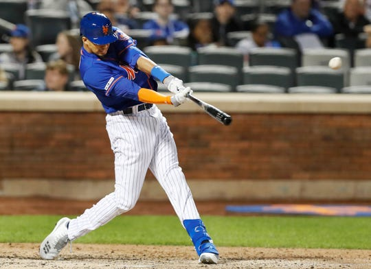 New York Mets pinch hitter Aaron Altherr hits a solo home run in his first at-bat as a Met during the sixth inning of a baseball game against the Detroit Tigers, Friday, May 24, 2019, in New York. (AP Photo/Kathy Willens)
