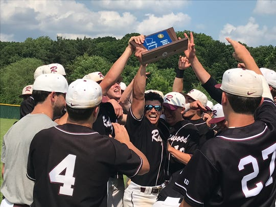 Ridgewood baseball players celebrate with their third straight North 1, Group 4 championship.