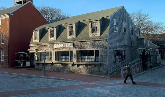 FILE - In this Jan. 7, 2019 file photo, a pedestrian walks past The Club Car Restaurant on Monday, J in Nantucket, Mass. Actor Kevin Spacey is accused of groping the teenage son of a former Boston TV anchor in the restaurant's crowded bar in 2016.