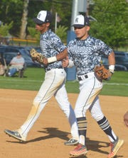 Rutherford seniors Brelyn Jones (left) and Nico Mundo and the rest of the Bulldogs could not get to the North 2, Group 2 final in a 5-1 loss to Madison.