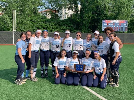 Members of the Immaculate Conception softball team celebrate their 8th straight sectional title.