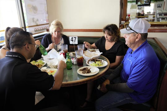 New Mexico State Police employees sit down for a meal at International Delights, 1245 El Paseo Rd., Friday, May 31, 2019.