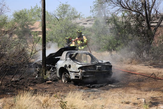 Firefighters work to extinguish a vehicle fire near Mile Marker 162 on US 70 on Friday, May 31, 2019.