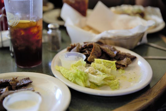 A lamb and side salad meal from International Delights, 1245 El Paseo Rd.  The restaurant recently announced it will close its doors June 15 but then shortly re-announced that it might stay open after all if business continues to thrive.