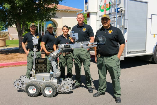 Members of the Doña Ana County Sheriff's Department pose with their robot at the 13th Annual Robot Rodeo, held May 13-17, 2019. Pictured from left are Sgt. Scott Bayles, Detective Michael Hinojosa, Detective Jessica Gonzalez, team commander Capt. Jon Day and Sgt. Ismael Porras.