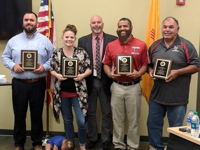 Picutred, left to right, Justin Parraz, Haley Finch, Loving Municipal Schools Superintendent Lee White, Tyler Finch and Serapio Parraz.