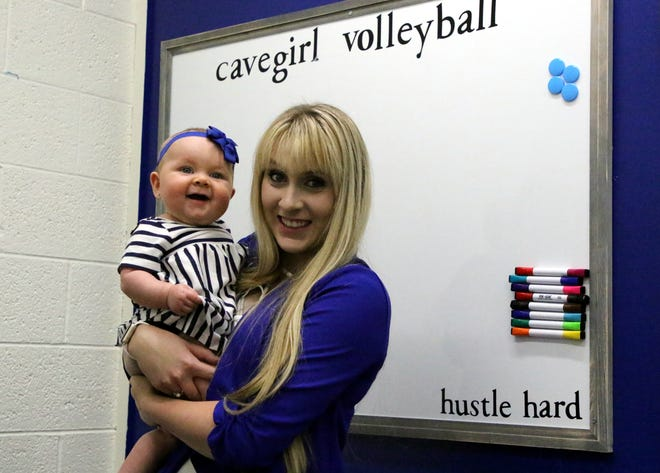 Carlsbad's new volleyball coach Hannah Hamblin and her seven-month old daughter, Bliss, pose inside Hamblin's office. Hamblin looks to revitalize a volleyball program that went 9-33 in its two previous seasons.