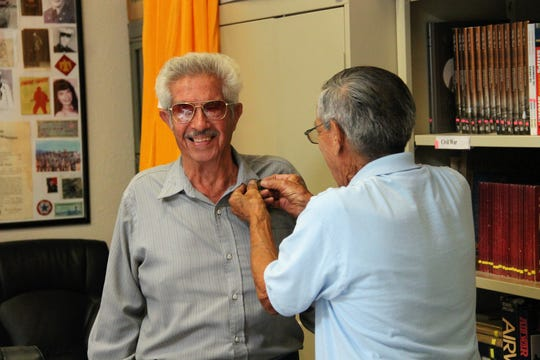 "Guillermo ""Willie"" Peña receives his Vietnam Veteran lapel pin commemorating his service in that war."