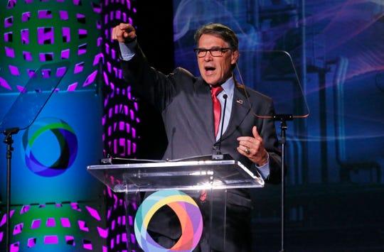 U.S. Energy Secretary Rick Perry speaks at an energy summit hosted by Utah Gov. Gary Herbert and attended by Wyoming Gov. Mark Gordon Thursday, May 30, 2019, in Salt Lake City.