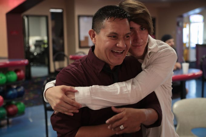 Eric gives his dad a hug at the bowling alley, Indio, Calif., May 29, 2019. They are spending the afternoon together before Eric's graduation.