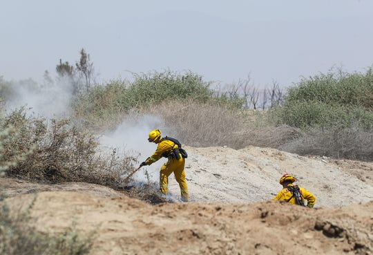 Firefighters work the 66 Fire in Thermal, May 31, 2019.
