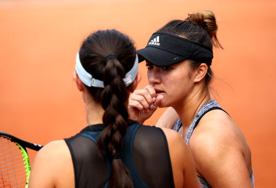 Americans Desirae Krawczyk and doubles partner Jessica Pegula, shown here on May 29, advanced to the Round of 16 at the French Open at Roland Garros Friday in Paris.