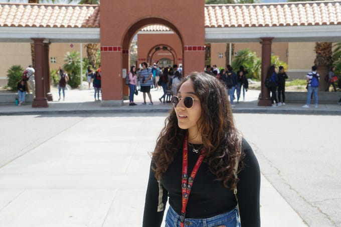 Palm Springs High School valedictorian Kimberly Inzunza walks out of Palm Springs High School after one of her final days of classes, Palm Springs, Calif., May 22, 2019.
