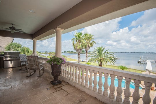 The balcony overlooks the Sound and features an outdoor kitchen.
