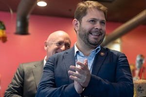 Rep. Ruben Gallego, who contemplated a run for the U.S. Senate in 2020, campaigns for his one-time potential rival Mark Kelly at Tres Leches Cafe on May 30, 2019.
