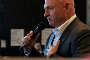 Mark Kelly speaks to the crowd during his campaign event at Tres Leches Cafe on May 30, 2019.