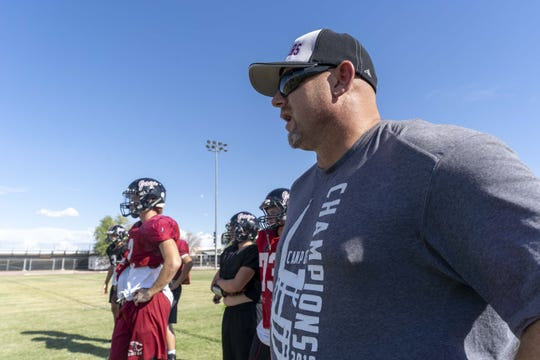 Desert Ridge High School football head coach Jeremy Hathcock coaches his players during a 2018 fall football practice in Mesa, Az.