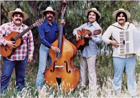 Ramon Sanchez's band, Los Alacranes Mojados, poses for a promotional photo around 1978.