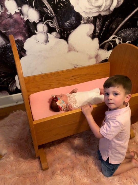 Isla Ensell sleeps in the cradle made by longtime Democratic consultant Rick DeGraw, but her brother Archer slept in it first, in 2015.
