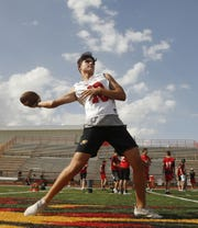 Chaparral's Brayten Silbor throws a pass during practice at Chaparral High School in Scottsdale, Ariz. on April 29, 2019.