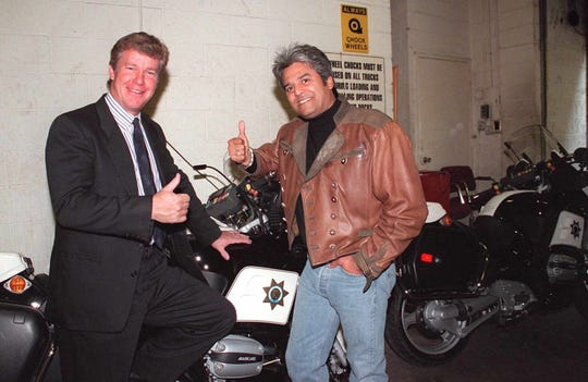 "Larry Wilcox (left) and Erik Estrada reunited on Oct. 20, 1998, for an episode of ""Live with Regis & Kathie Lee."""