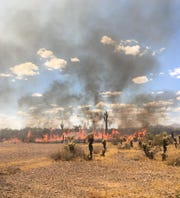 The White Wing Fire was burning near Wittmann on Thursday, about 35 miles northwest of central Phoenix.