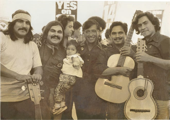Ramon Sanchez (holding his daughter) with Cesar Chavez (center) and other musicians around 1972.