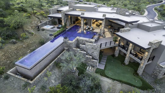 This 8,200-square-foot contemporary-style mansion topped the latest list of most expensive residential home sales in Fountain Hills, selling for $4.5 million. The mansion, purchased by John and Bobbi Jo Bell, has a 25-yard lap pool and a multi-hole putting green.