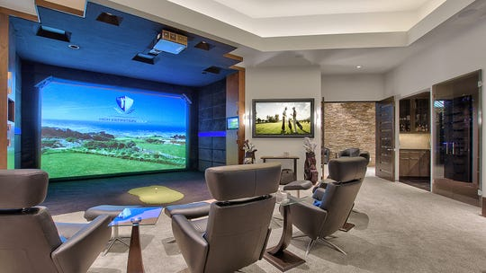 The $4.5M Fountain Hills estate, sold by Robert and M. Lisa Meyers, includes a golf simulator.