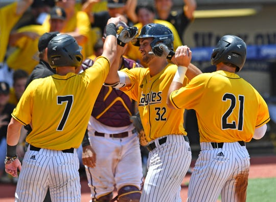 Southern Miss' Matt Wallner (32) celebrates with teammates Matthew Guidry (7) and Hunter Slater (21) after Wallner hit a three-run home run, scoring all three, in the fifth inning against Arizona State during the NCAA college baseball regional tournament, Friday, May 31, 2019,  in Baton Rouge, La. (Hilary Scheinuk/The Advocate via AP)