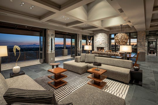 The $6.59M Scottsdale mansion, sold by William Thurwachter, features the use of stone, wood and modern elements in its architectural design.