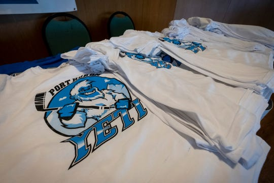 Port Huron Yeti T-shirts are on display during a press conference announcing the team Friday, May 31, 2019 at McMorran. Tickets and the team's schedule will be announced this summer.