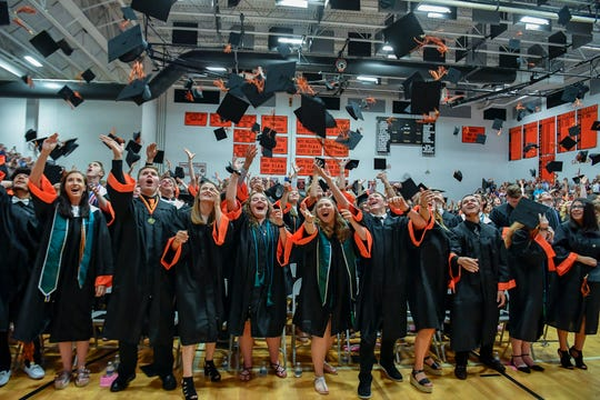 Northeastern High School Class of 2019 graduates toss their caps, Thursday, May 30, 2019.