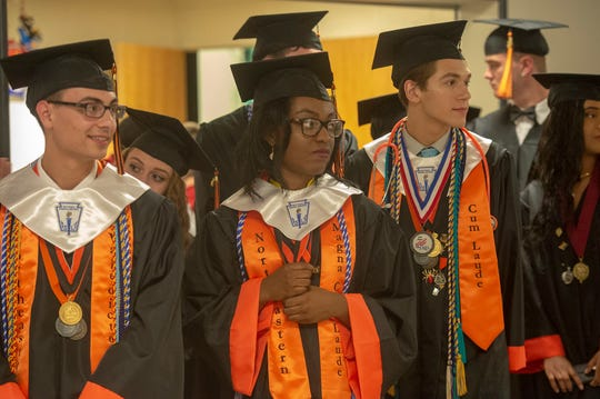 Honor students who finished in the top 10, five or two percent of the Class of 2019 wear stolls to denote their achievement Thursday, May 30, 2019 at Northeastern High School's graduation.