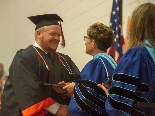 Northeastern Superintendent Dr. Stacey Sidle awards diplomas to graduating seniors on Thursday, May 30, 2019.