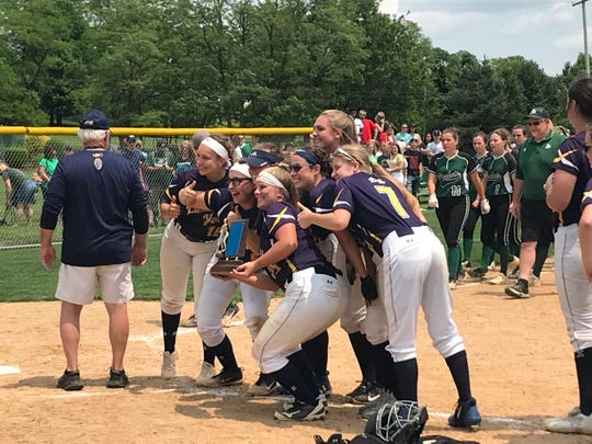 Eastern York softball players celebrate after winning the District 3 Class 4A title with a 1-0 win over James Buchanan on Friday.