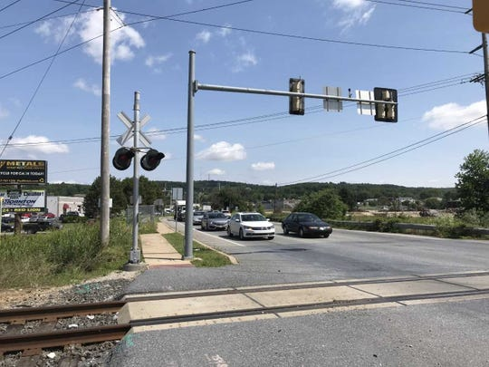 Friday morning traffic backs up at the railroad crossing on North Hills Road between Route 30 and East Market Street. The road will be closed last this month while the railroad replaces the crossing in anticipation of a PennDOT project to widen North Hills Road.