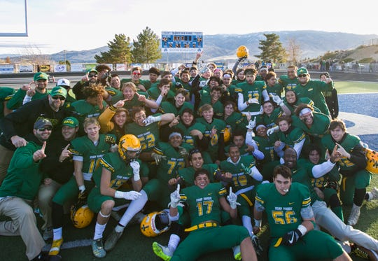 The Bishop Manogue Miners celebrate their 42-34 win over the Arbor View Aggies in the NIAA 4A State Semi-Final football game on Nov. 24, 2018.