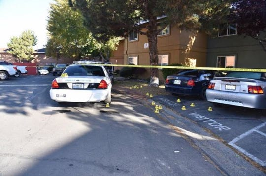 A photo showing 17 cartridge casings marked by yellow cones. The photo was taken Oct. 22, 2017 following a police-involved shooting at an apartment complex in Sparks.