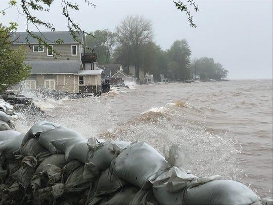 Waves batter the Lake Ontario shoreline in Hamlin.