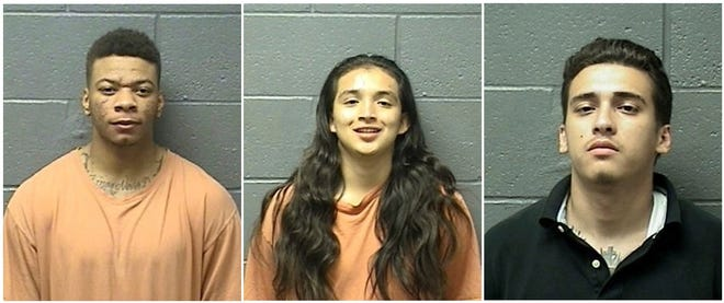 This combination of Thursday, May 30, 2019 booking photos provided by the Yuba County Sheriff's Department shows from left to right, Vivion Wallace, Avery Sanchez and Juan Barajas. The trio were arrested on suspicion of killing a man and wounding another in a car-to-car shooting in the Plumas Lake area of the Sacramento Valley. The Yuba County Sheriff's Office said investigators reviewed surveillance videos in over two dozen businesses to track the suspects' vehicle after the May 22 shooting on State Route 70. They identified and arrested the suspects on Thursday.  (Yuba County Sheriff's Department via AP)