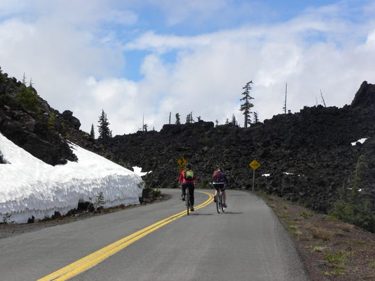 Cyclists from Eugene ride over McKenzie Pass Highway 242 during the season when only bicycle travel is open.