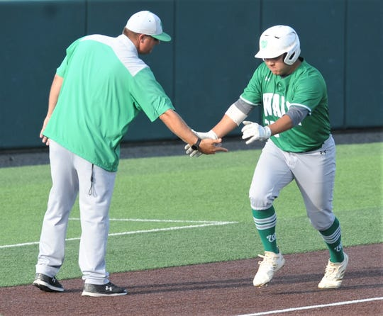 Wall's Charlie Mascorro, right, is congratulated by coach Jason Schniers after hitting a two-run home run to cap a three-run fourth inning against Brock. The Hawks beat Brock 3-2 in the opener of the Region I-3A championship series Thursday, May 30, 2019, at Abilene Christian University's Crutcher Scott Field.